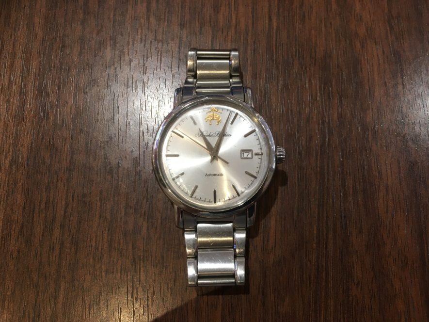 添乗員の腕時計